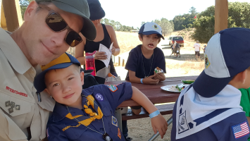 Father and scout camping